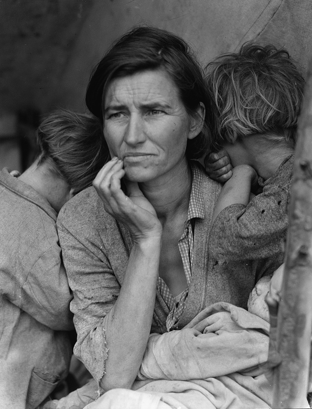 """Photo shows Florence Thompson with several of her children in a tent shelter as part of the """"Migrant Mother"""" series."""