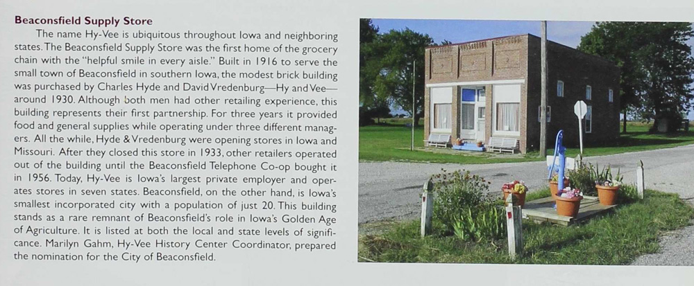 """A small brick building is Beaconsfield, Iowa, is recognized on the Register of Historic Places.  It was home to the Beaconsfield Supply Store, which was the first """"Hy-Vee"""" store."""