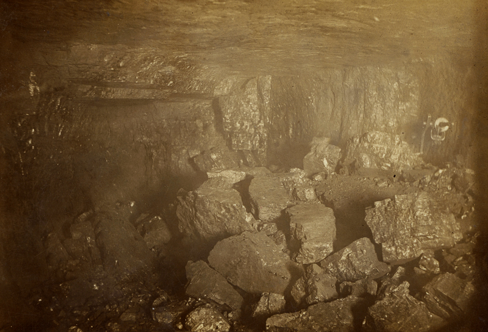Photograph inside Buxton #12 mine shows pieces of rock and coal that miners were working on moving circa 1910.