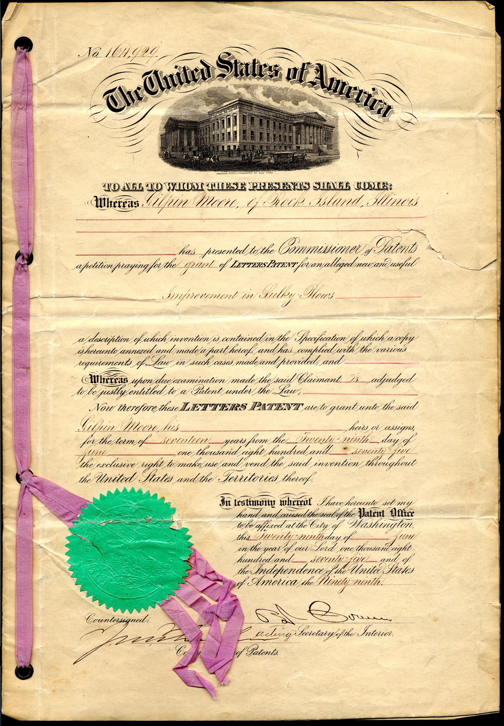 This document is the first page of a patent granted to Mr. Moore for his Gilpin Sulky Plow in 1875.