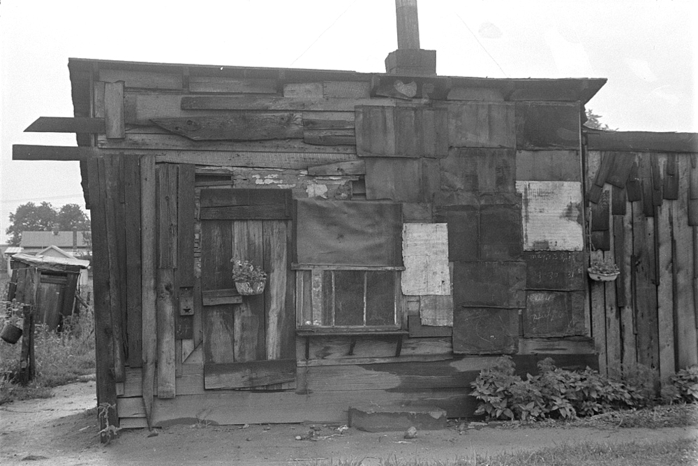 "The image of a decrepit shack that was one of many in ""Hoovervilles"" across American during the Great Depression."