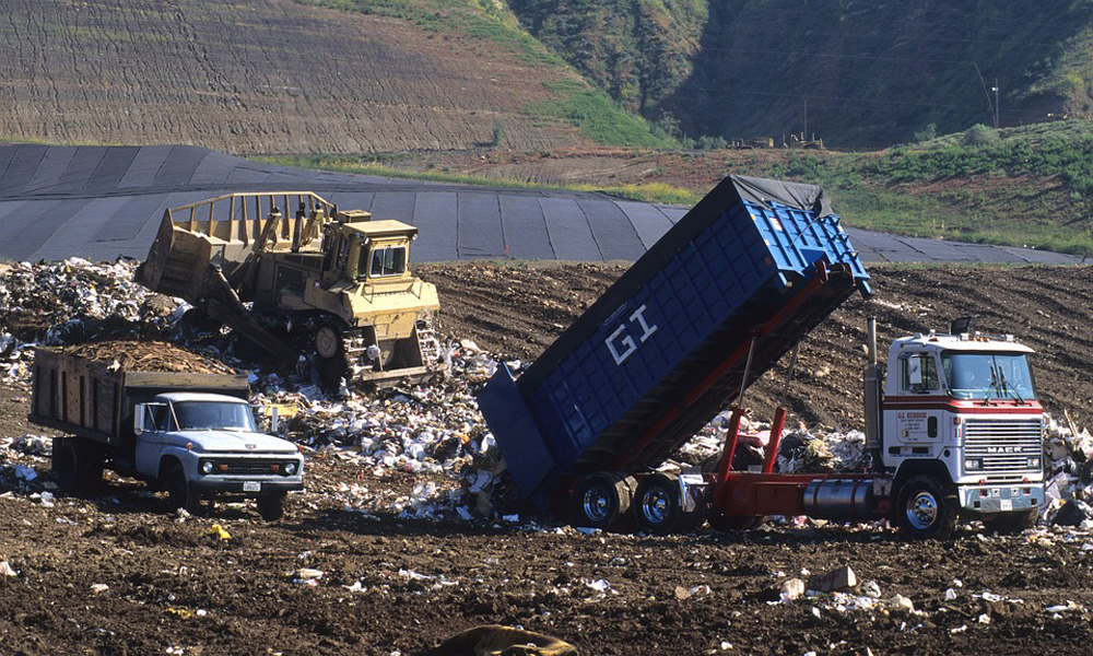 Truck Dumping Trash at a Landfill, Date Unknown