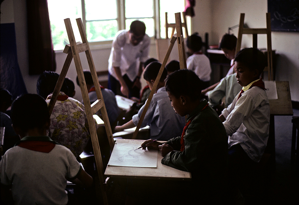 "Children learning to draw in an art class at a ""commune school"" in China."