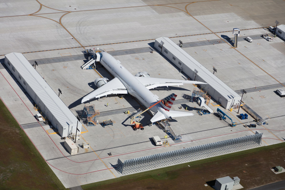 Very large 787 passenger aircraft seen under construction at Boeing factory.