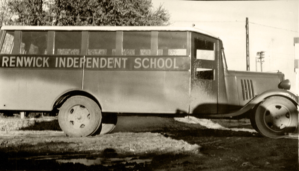 "Motorized, wooden bus with ""Renwick Independent School"" printed on the side."