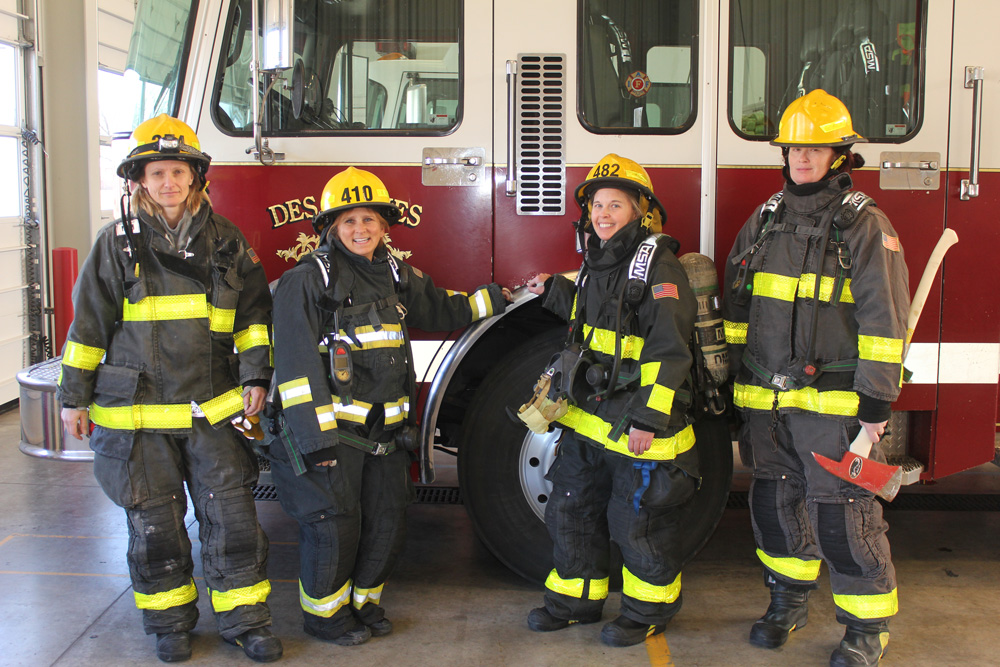 Four Des Moines Firefighters Stand by a Fire Engine, 2019