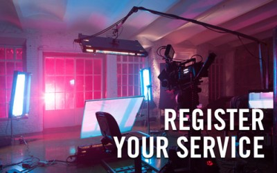 "Production crew set up with the text ""Register Your Service"""