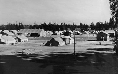 Photo by Robert Hemmig of a migrant camp.