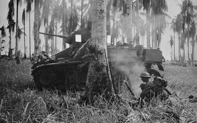 Black and white image of a tank and two soldiers in Burma.