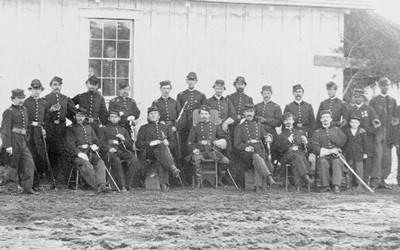 This photograph taken in April 1865 pictures officers of the 4th United States Colored Infantry at Fort Slocum near New York City. There are two rows of men total with seven men seated in the front and sixteen standing in the back. Two African-American NCO's stand on the very right hand side of the second row.