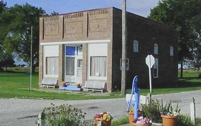 "A small brick building is Beaconsfield, Iowa, is recognized on the Register of Historic Places.  It was home to the Beaconsfield Supply Store, which was the first ""Hy-Vee"" store."