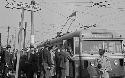 Workers board a trolley car in Baltimore, Maryland.