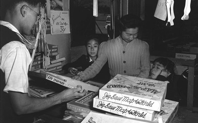 Japanese-American family shops for toys at the Manzanar Relocation Center.