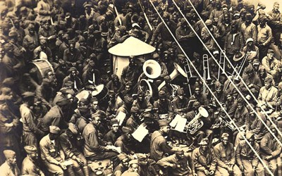 Photo of 803rd Pioneer Infantry Band on board the U.S.S. Philippines in Brest Harbor, France.