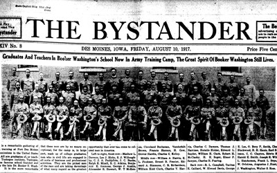 Formal photo and caption from The Bystander (August 10, 1917) of a group of 50 African American soldiers in training at Fort Des Moines.  These men are graduates and teachers from Tuskegee Institute, founded by Booker Washington.