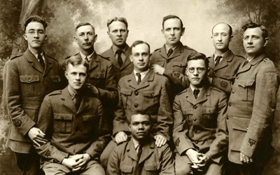 A military picture of 10 soldiers (1 African American) who are YMCA Educational Secretaries from Camp Dodge in 1918.