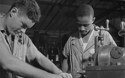 Black and white photograph of Two young men working with the NYA.
