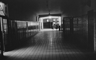 Photograph shows an almost-empty hallway at Central High School in Little Rock, Arkansas in 1958.