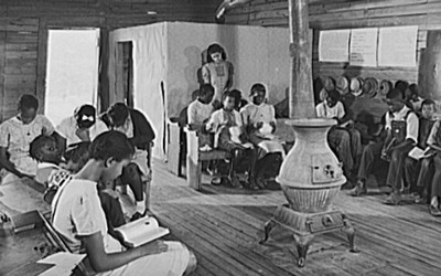 The photograph features a classroom of a school of only black children in Veazy, Georgia in 1941.