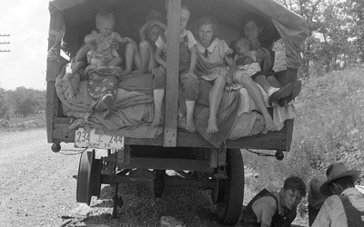 This image shows a family that was from Arkansas traveling during the dust bowl era.  The title indicates they anticipate ending up in California one day - as many families did.