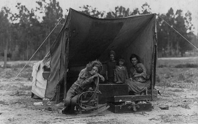 "Photo shows Florence Thompson with several of her children in a tent shelter as part of the ""Migrant Mother"" series."