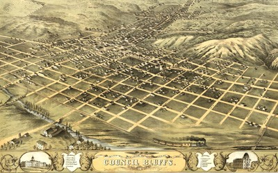 The lithograph of Council Bluffs is centered on Broad Street as it ran from the northeast to the Missouri River. The streets are organized in a grid pattern, with the commercial buildings centered on Broad and Main Streets and residential buildings spread across the city. The densest areas are in the area of Broad and Main Streets.