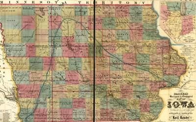 The map shows the state of Iowa in 1856 with all counties named and divided into sections. Iowa's rivers are shown and labeled. A boundary line shows the limits of Iowa's coalfield and deposits of iron, lead, copper, and coal. The locations of Iowa's sixteen railroads are shown, designated as completed or building/proposed.