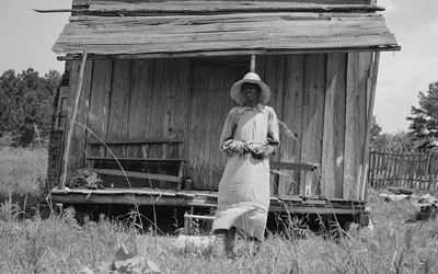 Sharecropper's Wife and Cabin near Jackson, Mississippi, June 1937