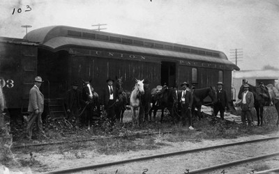 Union Pacific posse car being loaded with men and horses in 1900