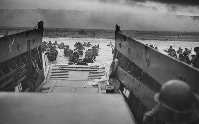 This photograph from the Franklin D. Roosevelt Library in Hyde Park, New York, shows American soldiers landing in Normandy, France, on the morning of June 6, 1944, the beginning of the long-awaited invasion to liberate continental Europe from the grip of Nazi Germany