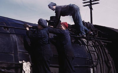 A group of three women cleaning an H-Class locomotive.