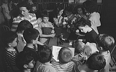 Third-Grade Students Checking Out Books at School Library in New York, June 1943