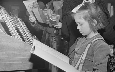 Little Girl Looking at Book in R.H. Macy and Company Department Store in New York, December 1942