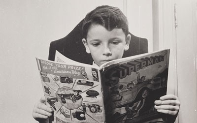 German Refugee Child Reading a Comic Book, October 1942