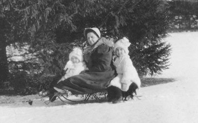 "Ellen and Barbara Douglas on a Sled with their Nanny ""Danny,"" Date Unknown"