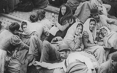 Emigrants huddled together on their journey to America in 1902 by William H. Rau.