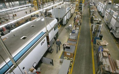 Workers assemble recreational vehicles at Winnebago Industries in Forest City in a file photo from 2013. Company officials announced on Friday an additional plant will be opened in Waverly.