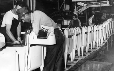 Employees at work on washing machine assembly line in Maytag plant. Newton, Iowa. October 1949.