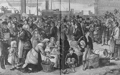 This 1874 engraving shows men, women and children on a dock in Queenstown, Ireland preparing to board a ship that will take them to New York.