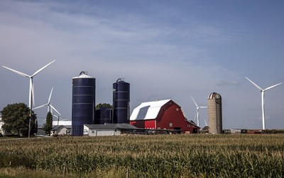 Farm Scene Including a Bright-Red Barn, Three Silos (one vintage, two modern), and Quite Modern Wind Turbines in Hardin County, Iowa