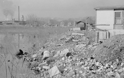 """Dubuque """"Shacktown"""" Near the Banks of a Polluted Stream, April 1940"""