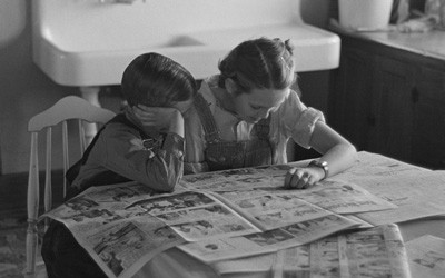 Children Reading the Sunday Newspaper in Dickens, Iowa, December 1936