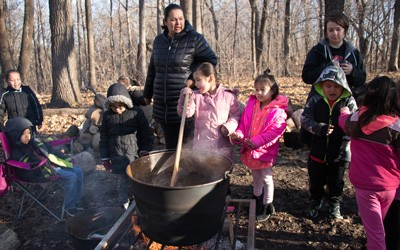 Meskwaki Members Show Settlement Students the Maple Syrup Process, March 2018