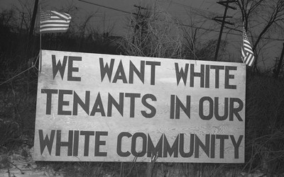 A protest sign placed outside a housing project for African Americans in Detroit, Michigan.  Detroit was one of many northern cities African Americans migrated to from the South during the Great Migration.