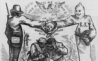 """In his 1874 cartoon titled """"The Union as It Was,"""" Thomas Nast depicts a member of the Ku Klux Klan and a member of the White League shaking hands atop a skull and crossbones that rests above an African-American woman and man huddled over their dead child as a school house burns and an African-American is lynched in the background."""