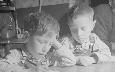 Lopez Children Doing Their Homework in Trampas, New Mexico, January 1943