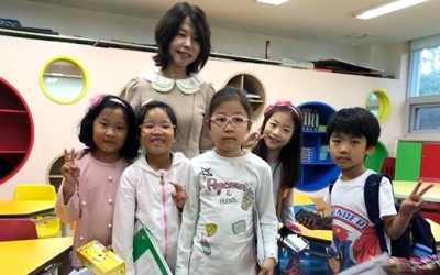 First graders with their teacher in South Korea.