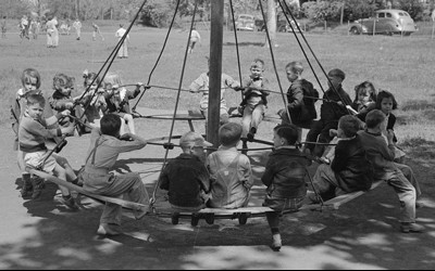 Students swinging on a playground in Texas 1939.