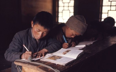 Young boys reading and writing in school, Lachung, Sikkim.