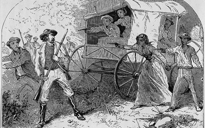 Cartoon shows fugitive slaves with wagon pointing guns at slave-catchers.
